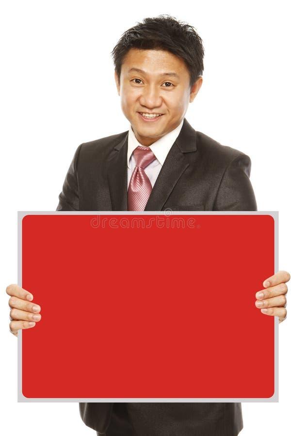 Homem de negócios que guardara a mensagem vazia foto de stock royalty free