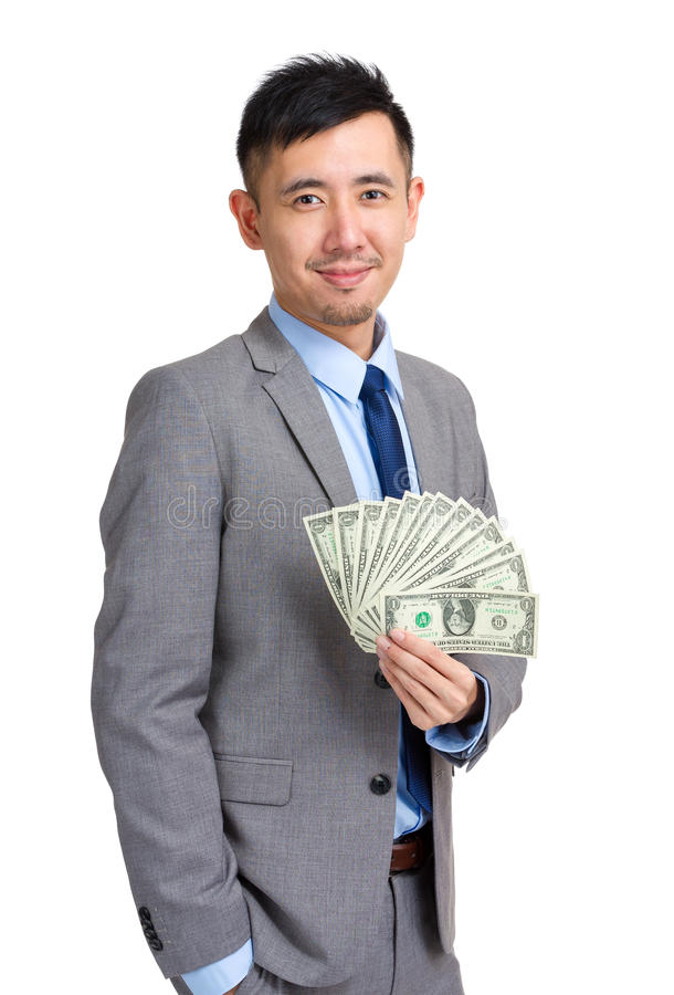 Homem de negócios que guardara o dinheiro fotografia de stock royalty free