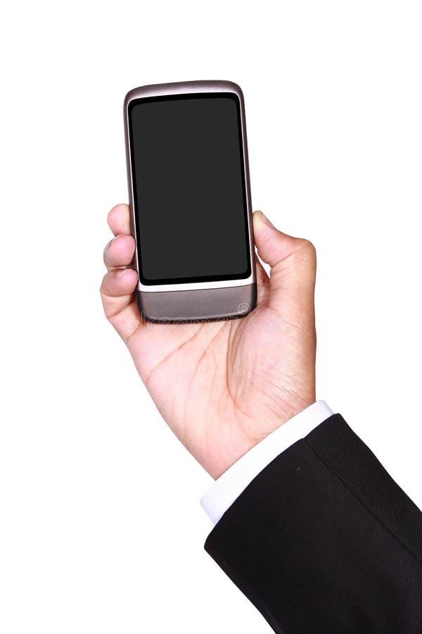 Homem de negócios que guardara o telefone esperto fotos de stock