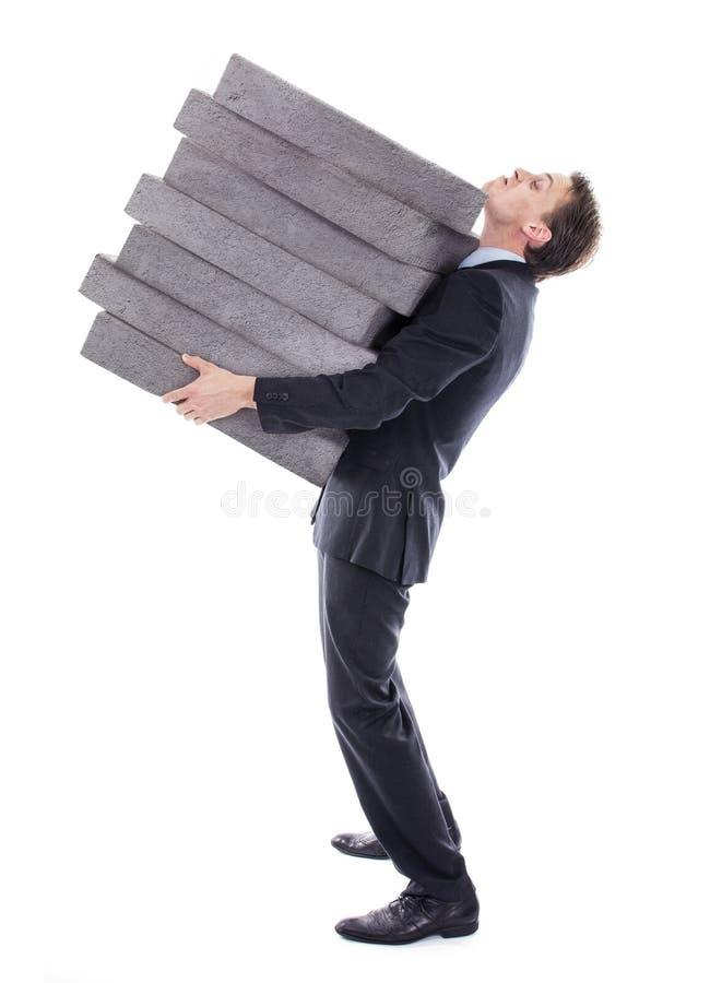 Homem de negócios que leva a carga alta fotografia de stock