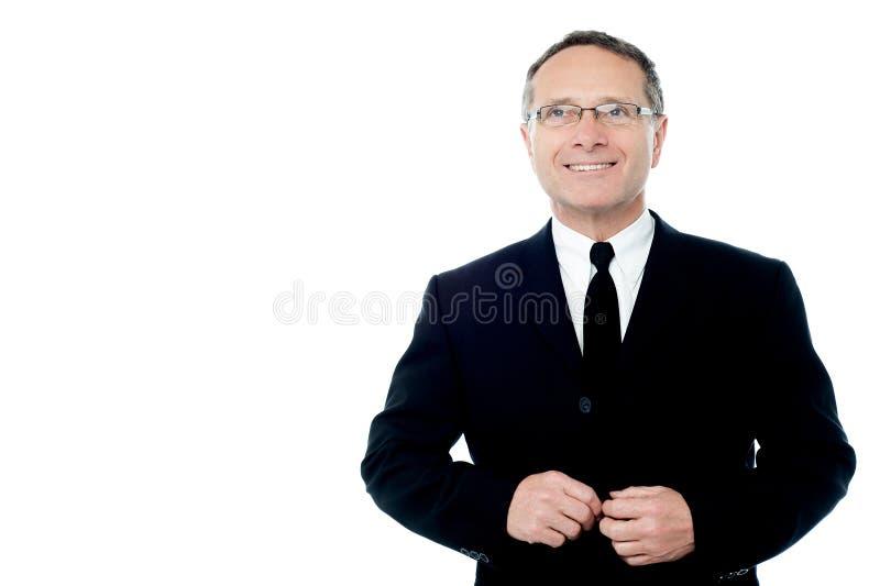 Homem de negócios que levanta à câmera sobre o branco fotografia de stock royalty free