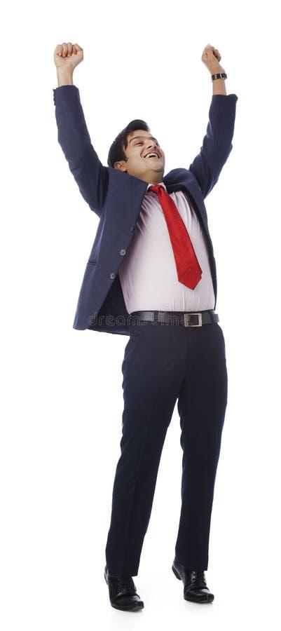 Homem de negócios que levanta suas mãos fotografia de stock royalty free