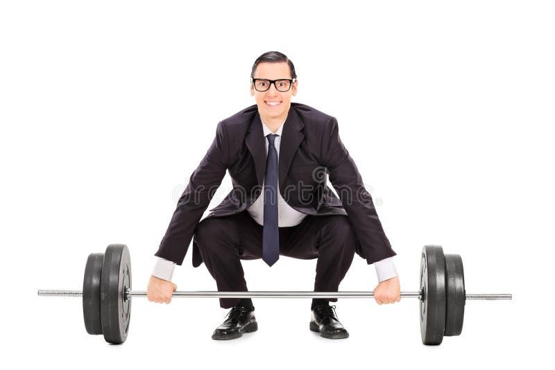 Homem de negócios que levanta um peso pesado fotografia de stock