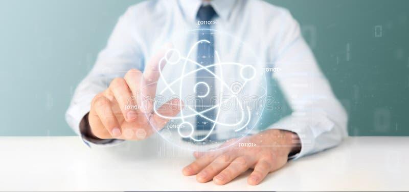 Homem de negócios que mantém um ícone do átomo cercado por dados foto de stock royalty free