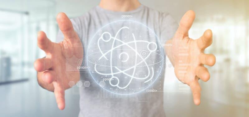 Homem de negócios que mantém um ícone do átomo cercado por dados imagem de stock