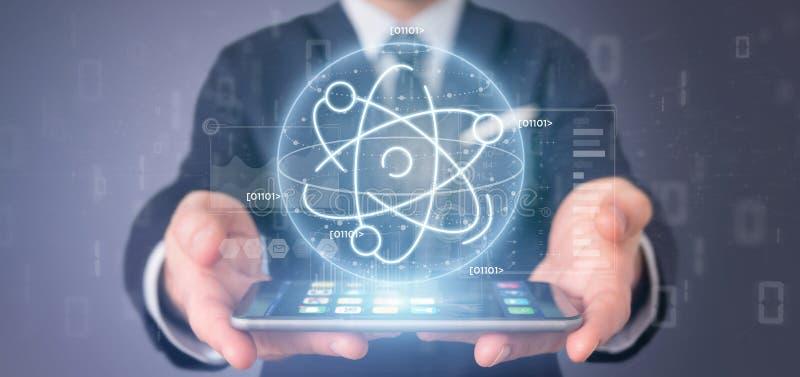Homem de negócios que mantém um ícone do átomo cercado por dados fotografia de stock royalty free