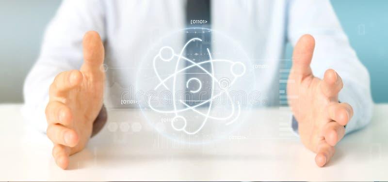 Homem de negócios que mantém um ícone do átomo cercado por dados fotos de stock royalty free