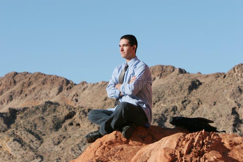 Homem de negócios que meditating imagens de stock