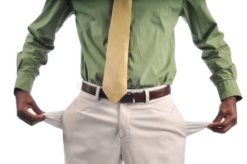 Homem de negócios que mostra bolsos vazios imagem de stock