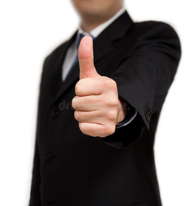 Homem de negócios que mostra o tiro do close up dos polegares acima - fotos de stock
