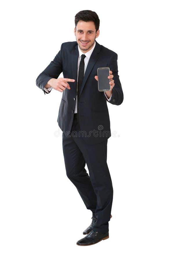 Homem de negócios que mostra a tela do telefone fotografia de stock