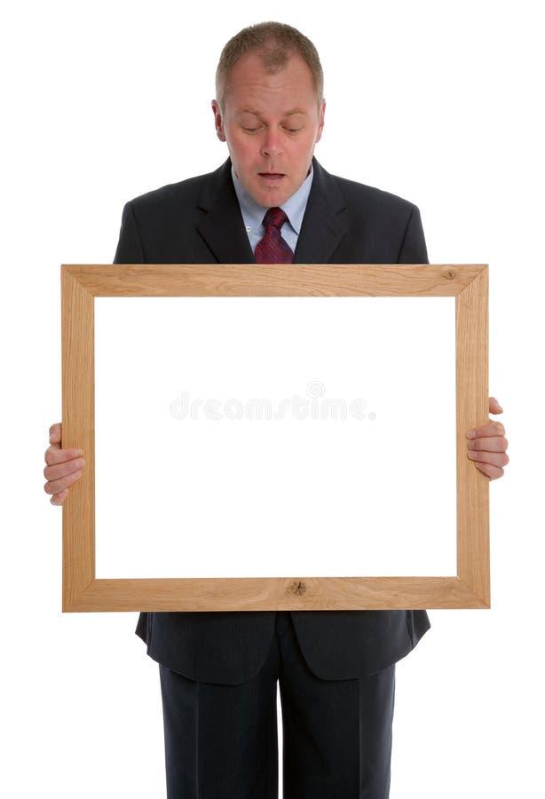 Homem de negócios que olha no frame imagens de stock