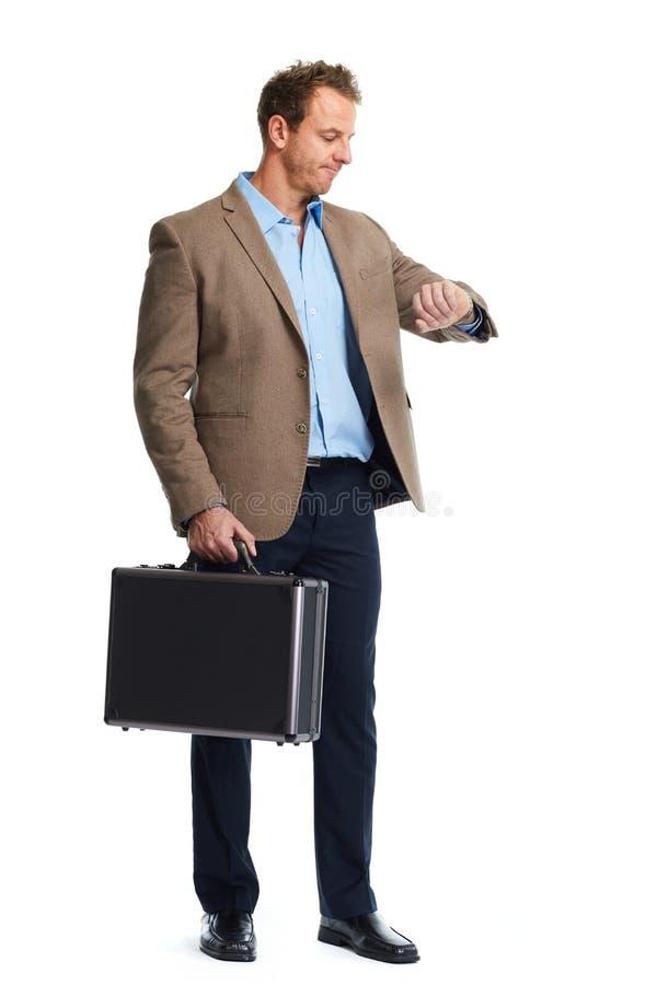Homem de negócios que olha o relógio imagens de stock royalty free