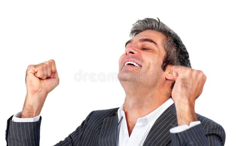 Homem de negócios que perfura o ar na celebração fotografia de stock