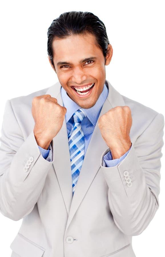 Homem de negócios que perfura o ar que comemora uma vitória foto de stock
