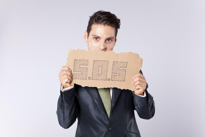 Homem de negócios que precisa alguma ajuda imagens de stock royalty free