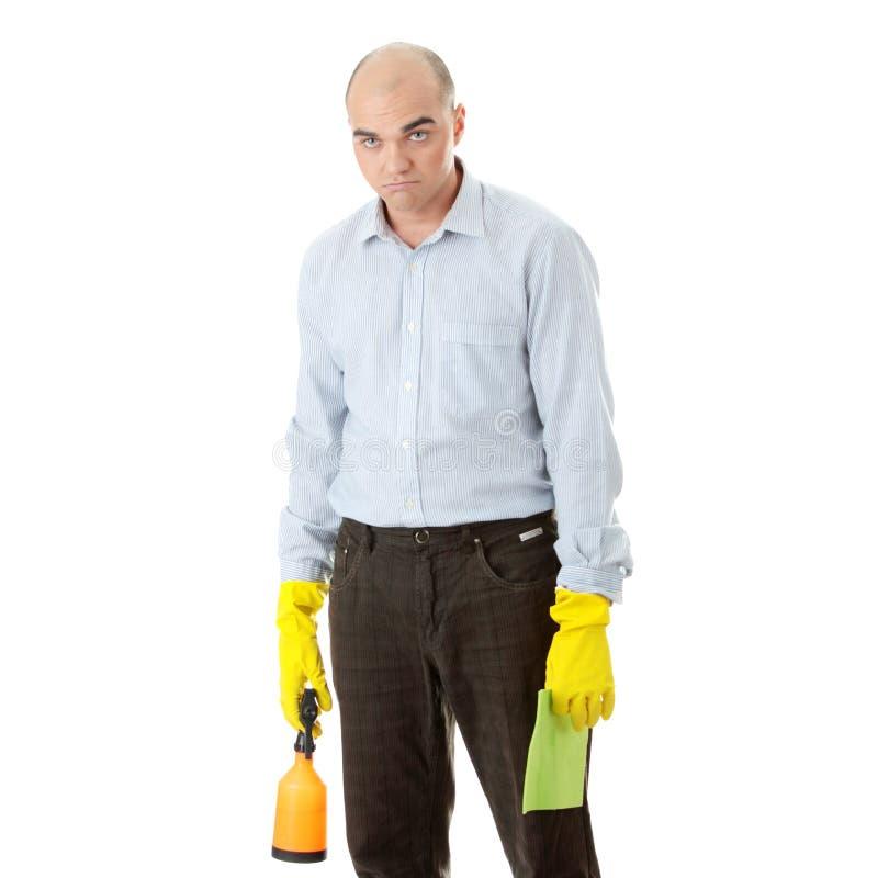 Homem de negócios que prende acessórios de uma limpeza foto de stock