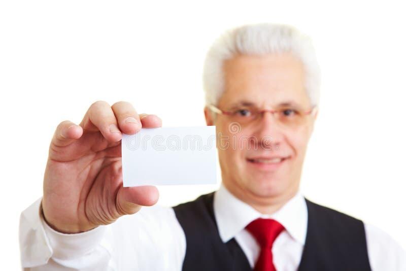 Homem de negócios que prende seu negócio imagem de stock royalty free