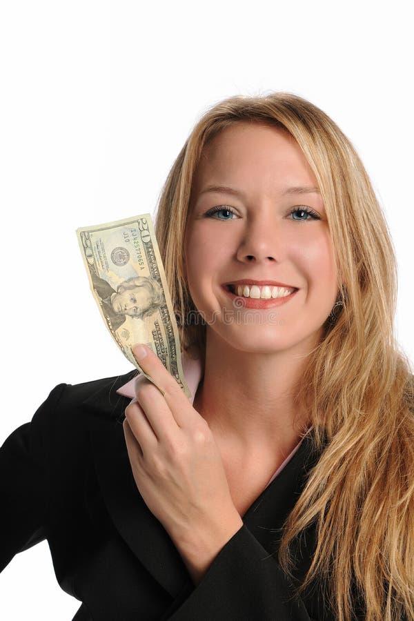 Homem de negócios que prende uma conta de dólar vinte imagem de stock royalty free