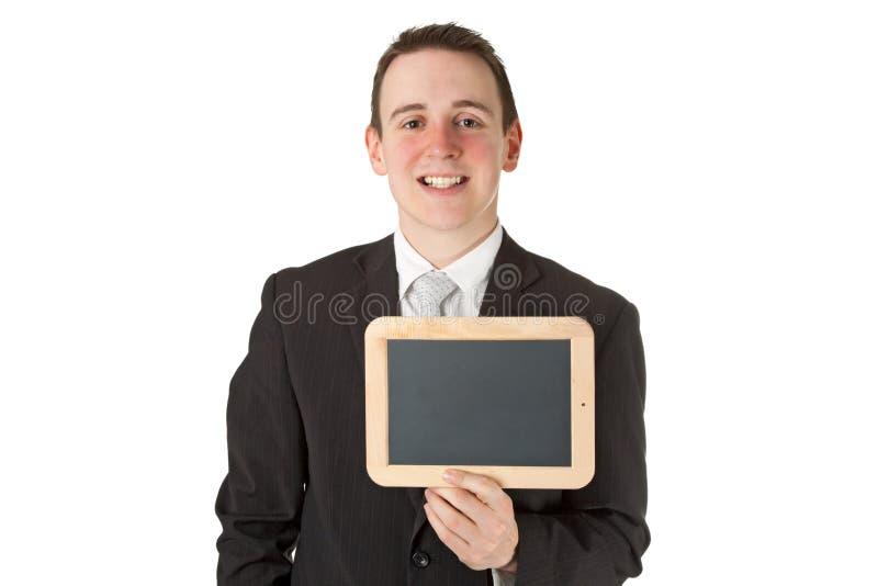 Homem de negócios que prende uma placa preta imagem de stock royalty free