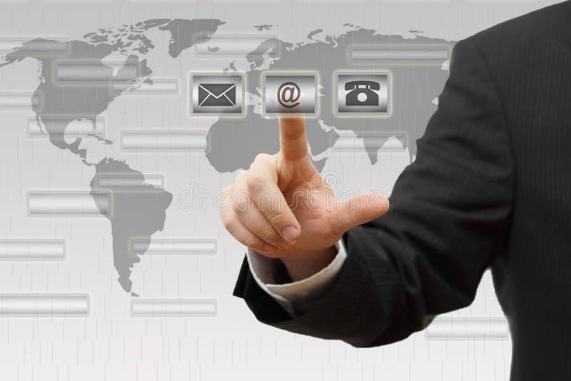 Homem de negócios que pressiona (correio, telefone, email) botões virtuais imagem de stock royalty free
