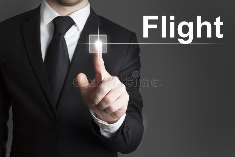 Homem de negócios que pressiona o voo virtual do botão fotografia de stock