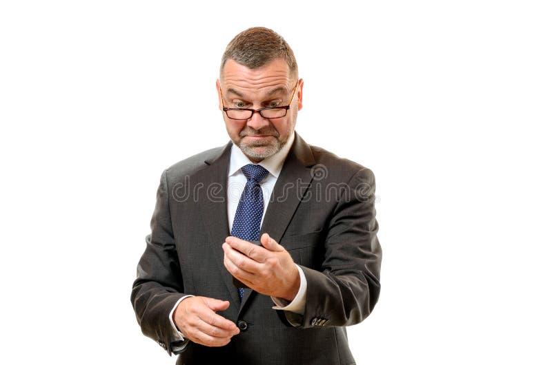 Homem de negócios que puxa a cara desdenhosa imagem de stock royalty free
