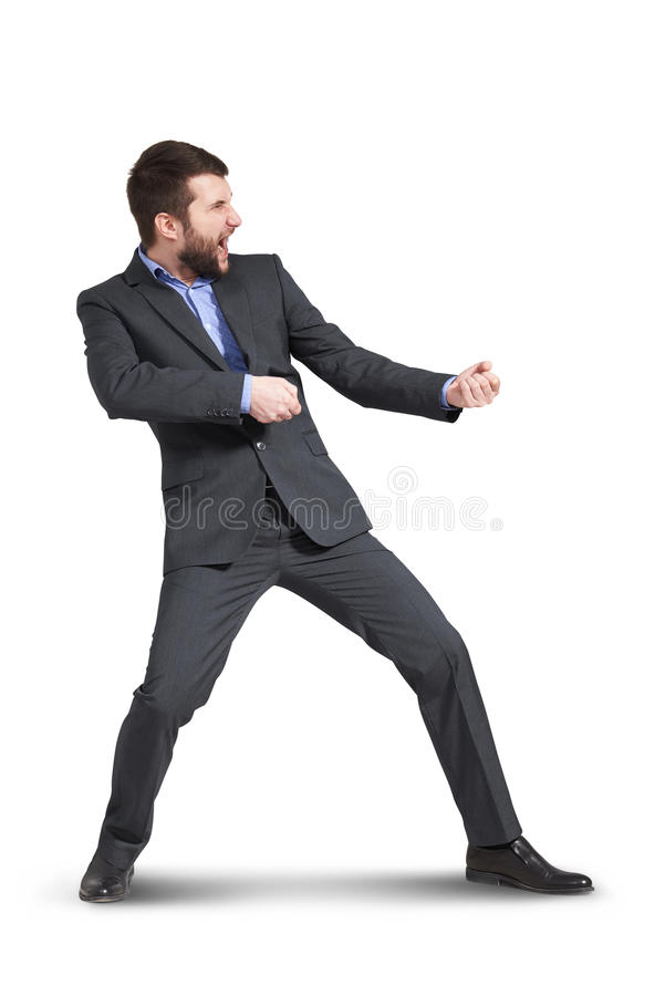 Homem de negócios que puxa a corda invisível fotos de stock