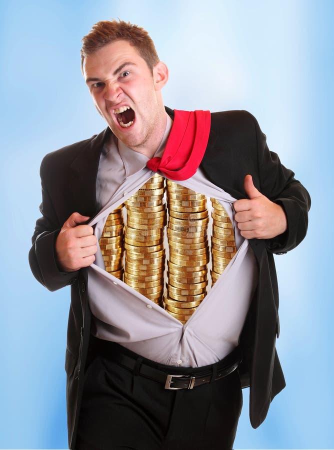 Homem de negócios que rasga suas moedas da camisa nele fotos de stock royalty free