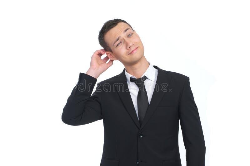 Homem de negócios que risca sua cabeça foto de stock