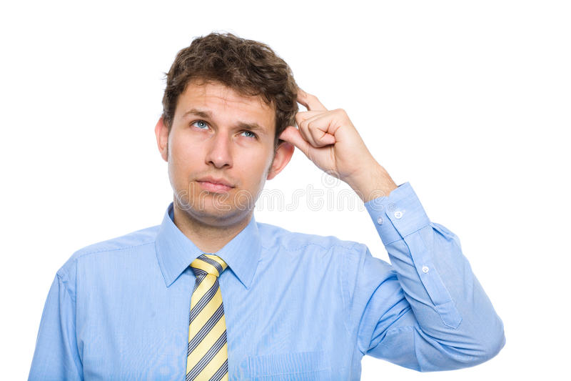 Homem de negócios que risca sua cabeça, decisão dura foto de stock