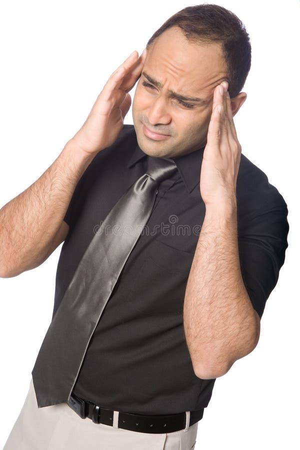 Homem de negócios que sofre da dor de cabeça fotos de stock