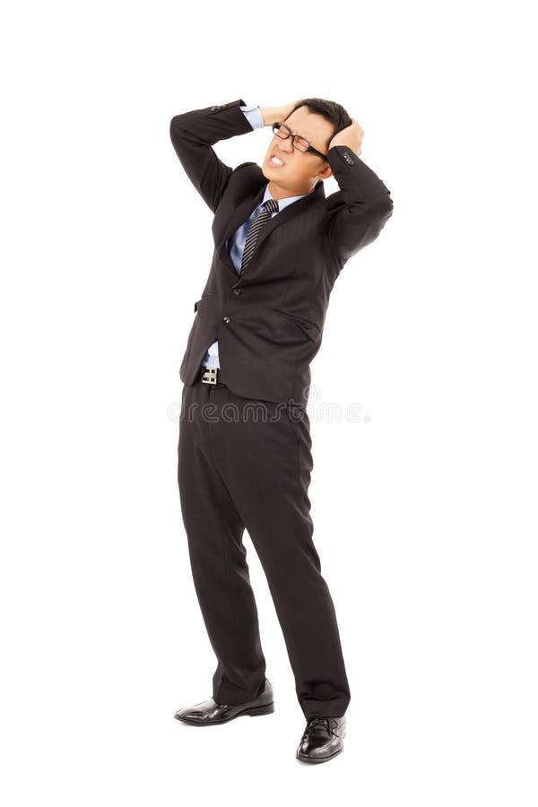 Homem de negócios que sofre do esforço e de uma dor de cabeça imagem de stock royalty free