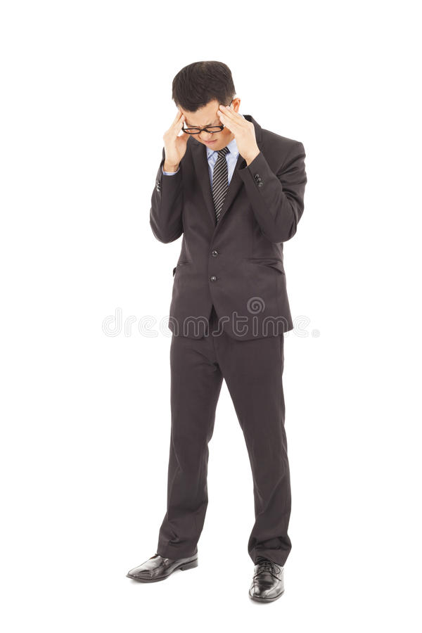 Homem de negócios que sofre do esforço e de uma dor de cabeça fotografia de stock
