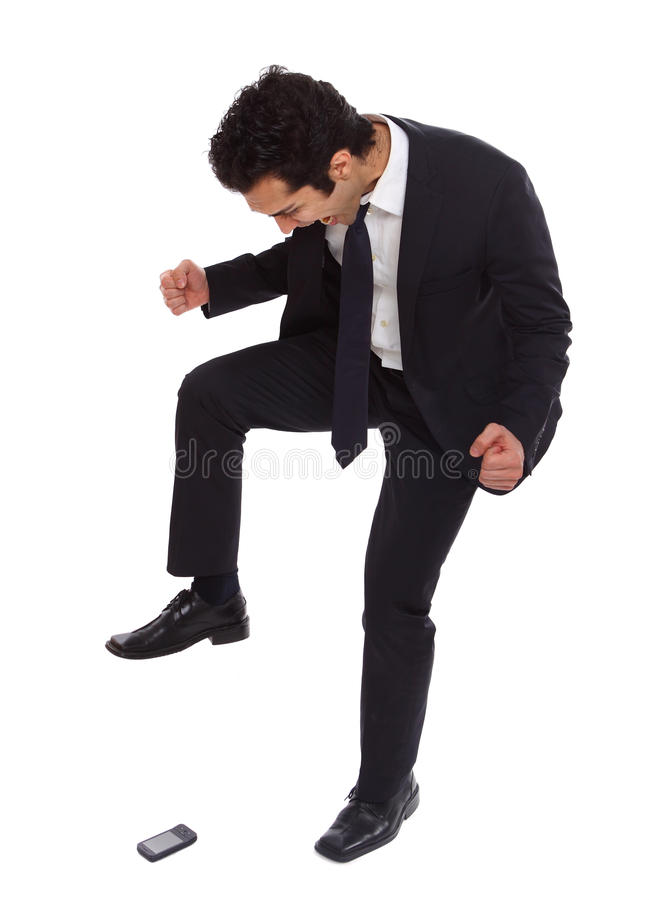 Homem de negócios que stomping em seu phoneq imagem de stock