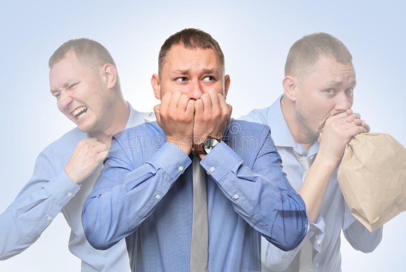 Homem de negócios que tem o ataque de pânico no fundo branco imagem de stock royalty free