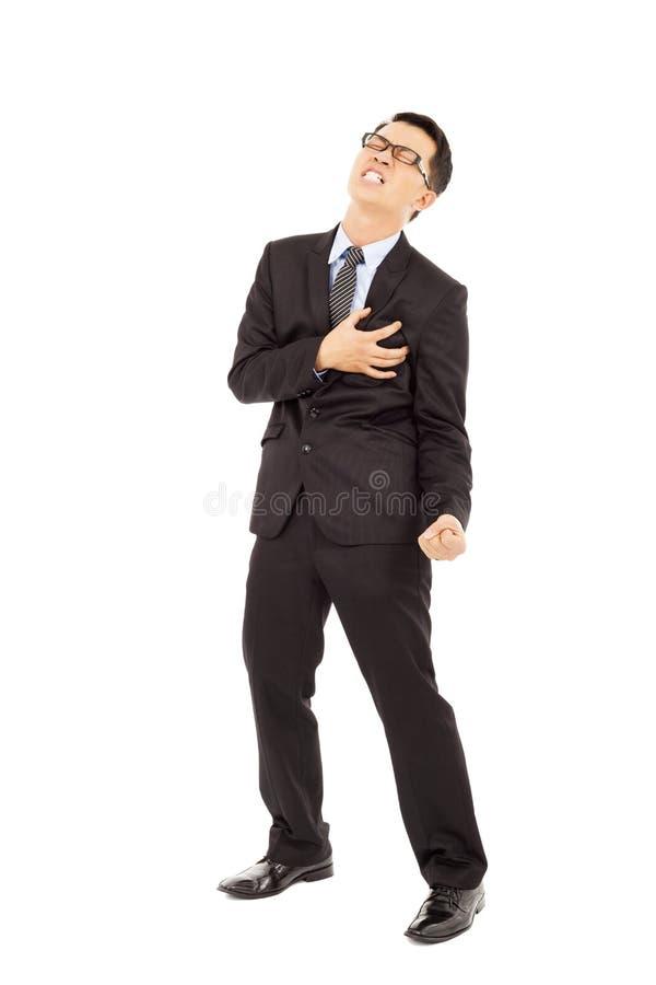 Homem de negócios que tem um cardíaco de ataque fotos de stock