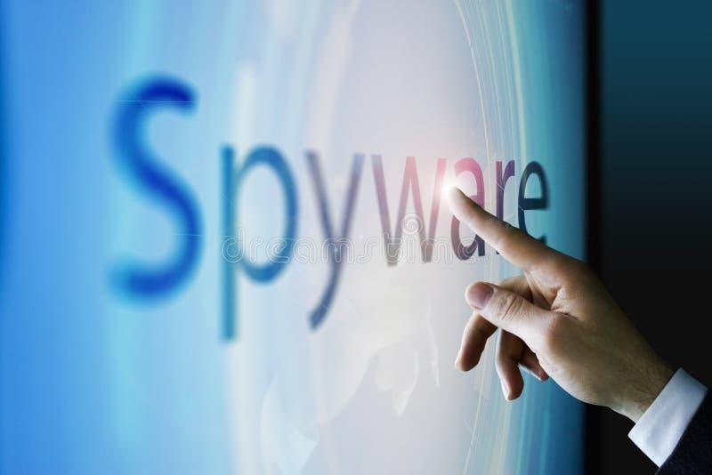 Homem de negócios que toca na tela sobre o spyware imagens de stock royalty free