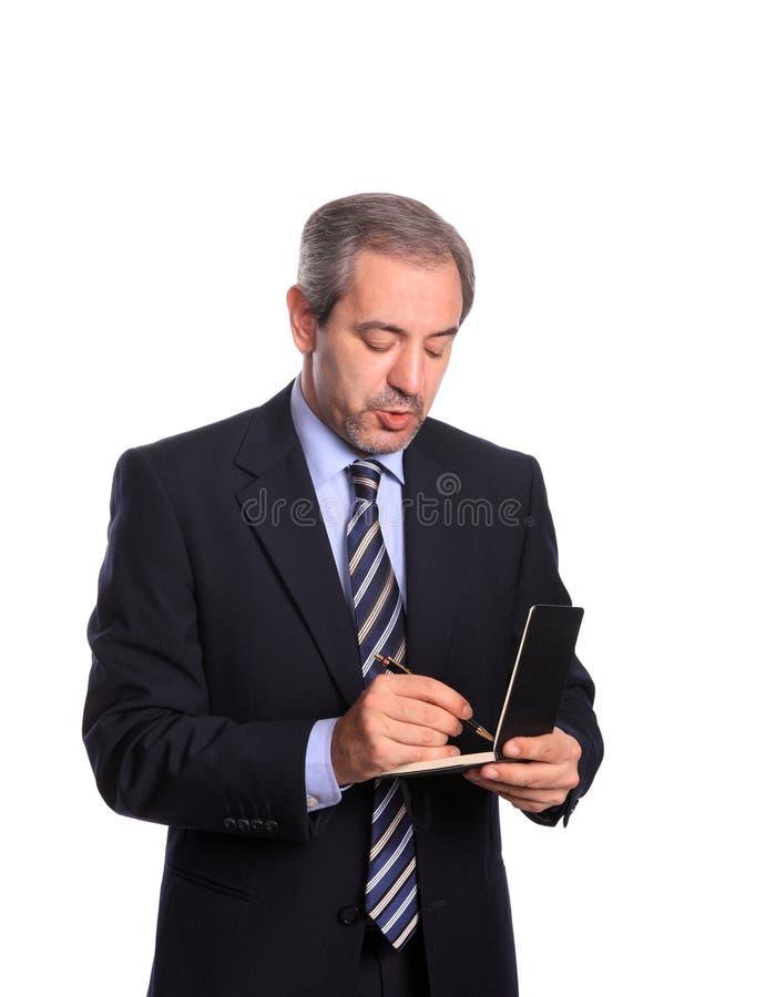 Homem de negócios que toma notas imagem de stock