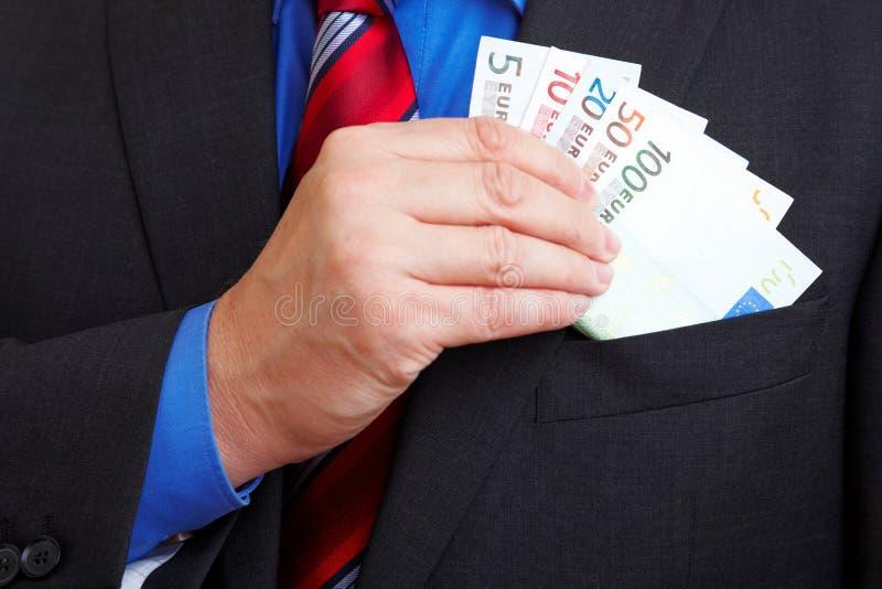 Homem de negócios que toma o euro- dinheiro fotos de stock royalty free