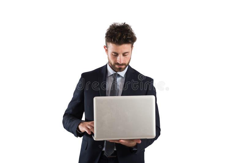 Homem de negócios que trabalha com portátil fotos de stock royalty free