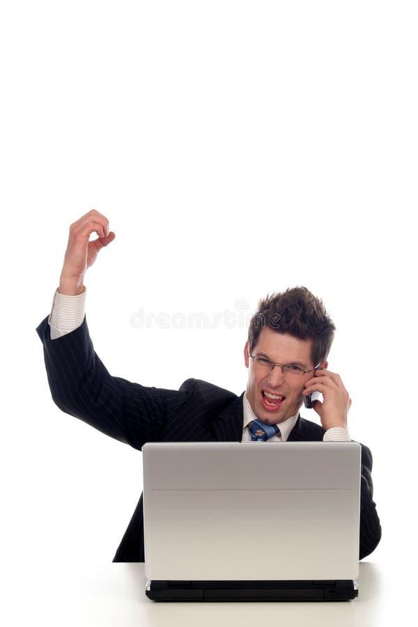 Homem de negócios que usa o portátil foto de stock