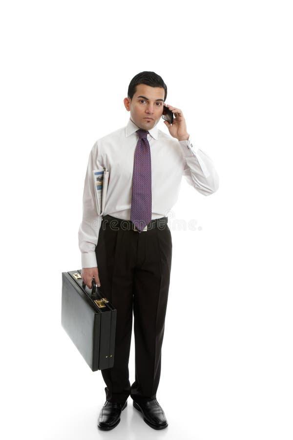 Homem de negócios que usa o telefone de pilha foto de stock royalty free