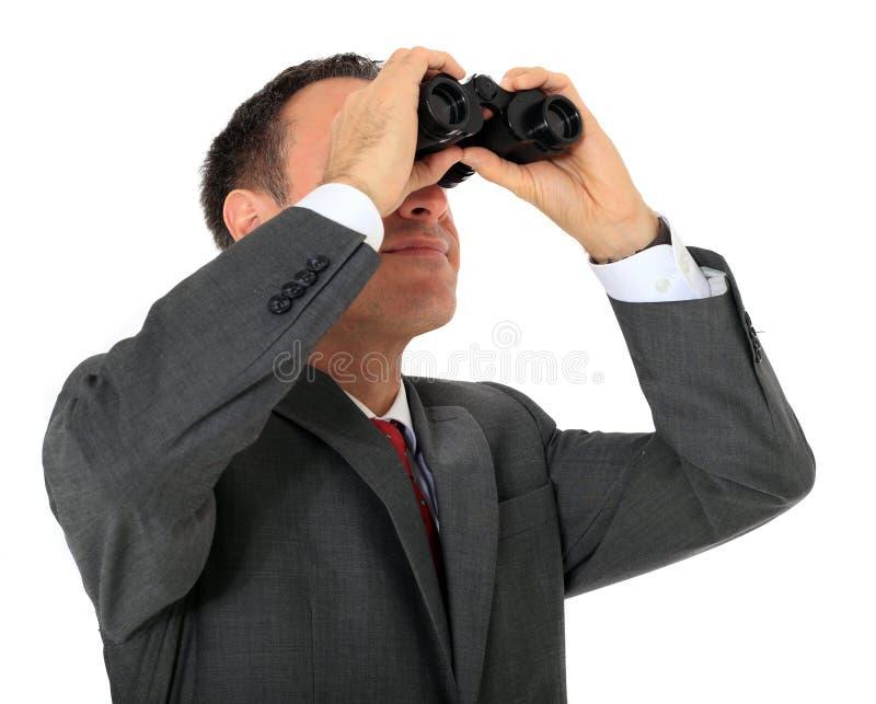 Homem de negócios que usa spygalss fotos de stock