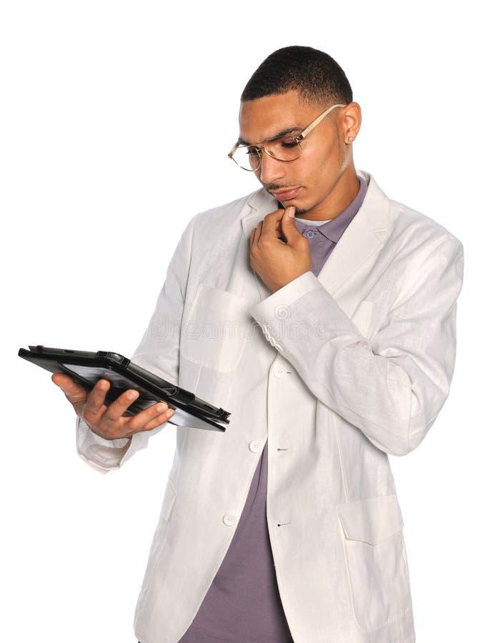Homem de negócios que usa a tabuleta eletrônica fotos de stock royalty free