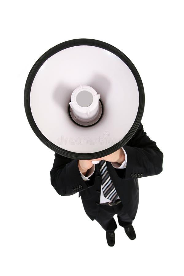 Homem de negócios que usa um megafone imagem de stock royalty free