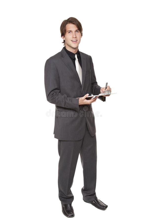 Homem de negócios - questionário da prancheta imagem de stock
