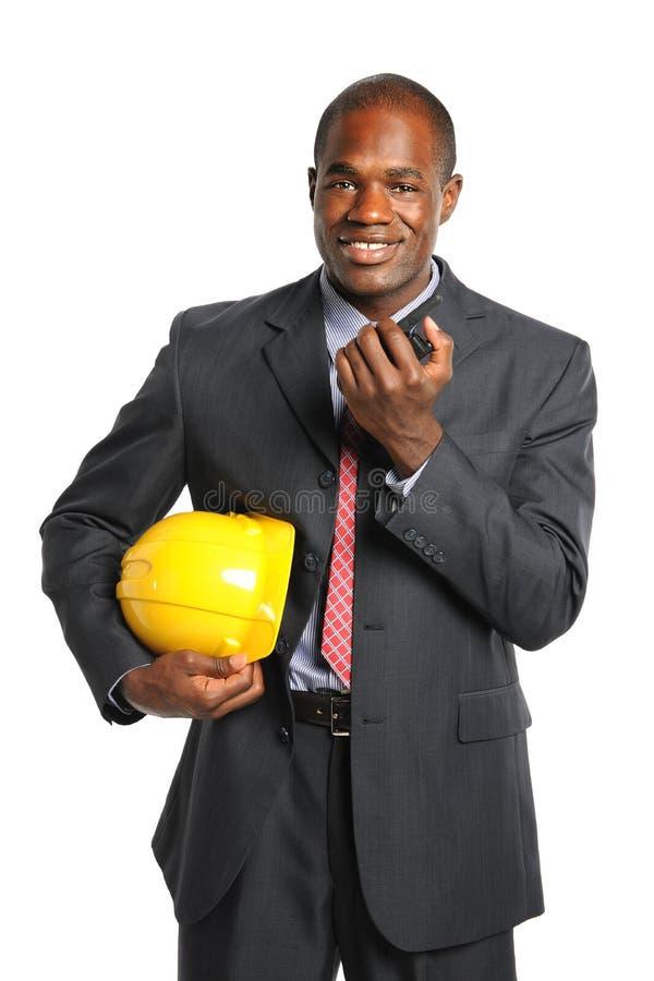 Homem de negócios With Radio e capacete de segurança fotografia de stock