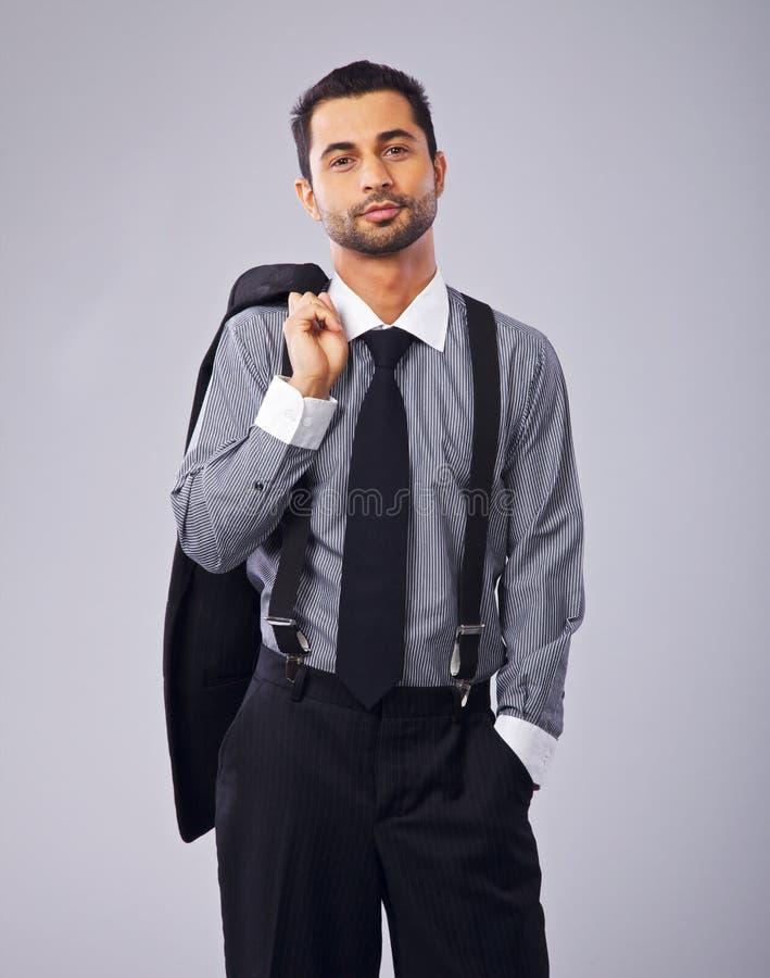 Homem de negócios relaxado Holding His Coat imagem de stock royalty free