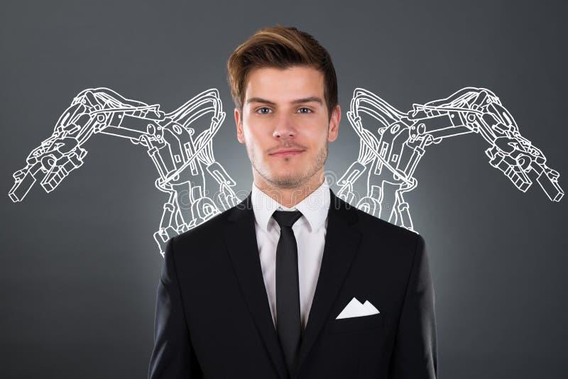 Homem de negócios With Robotic Arms imagem de stock